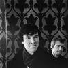 aqua_eyes: greyscale Sherlock (bbc) smirking withJohn in bkground. Wallpaper in background. (Sherlock - Wallpaper)