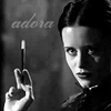 trialia: Adora Belle Dearheart, cigarette in holder in hand, black-and-white. (discworld] adora belle - dark/smoke)