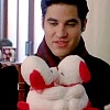 lilyleia78: Blaine Anderson holding stuffed kissing dogs (Glee: Blaine puppylove)