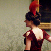 ar: Lady Mary Crawley facing away from the camera in a red dress, walking towards an unknown destination. (downton abbey - mary wandering)