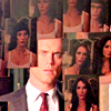 veleda_k: Neal from White Collar looking into Rebecca's mirror, which is covered with pictures of her (White Collar: Neal/Rebecca mirror)