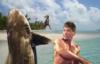 mapref37n33w: It's Charles Bronson punching a fucking shark, dude. (charlesbronsonpunchingashark)