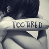 "revolutions: A girl with her arms crossed over her face; ""TOO TIRED"" is written on her forearm. (too tired.)"