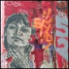 killer_quean: Black and white image of a woman's face, wheat-pasted onto a red and orange graffiti-covered wall. (SF)