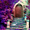 sylvaine: Old stone steps leading up to a wooden door with lilacs flowering on either side. ([gen] secret garden)