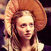 lark_in_flight: Cosette in a large bonnet, looking neutral or slightly uncertain (Default)