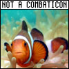 dunmurderin: A clownfish, orange and white, with a banner saying he is NOT a Combaticon!  So no one mistakes him for one, y'know? (pipes from lilformers)