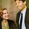 notevenblondes: Mulder and Scully laughing or at least smiling widely (Mulder and Scully laughing)
