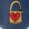 "lilliburlero: street art, closed padlock with heart, reading ""free love"" (free love)"