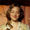 lark_in_flight: Cosette smiling down, eyes closed, in private happiness or smug satisfaction (a heart full of joy)