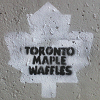 violsva: A graffiti white maple leaf surrounding the words Toronto Maple Waffles (toronto maple waffles)