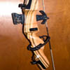 arrow_rest: part of a wooden recurve riser and metal sight (riser and sight)