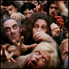oxfordtweed: A large group of zombies reaches toward the camera (Zombies - Swarm)
