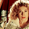 juniperphoenix: River Song in white, holding a gun (DW: River)