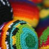 littlemousling: Cropped photo of four colorful hacky sacks (juggling)
