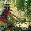 bikingandbaking: me as a teenager in a tie-dye shirt on a bike (tie dye)