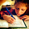 femmeremix: Image of a young girl writing in a notebook. (writing)