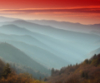 rhi: Sunset and rising clouds in the Smokies, ripples of mountains with fog below and red light pouring down onto them (mountains)
