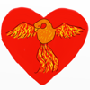 phoenixsong: An orange bird with red, orange and yellow wings outstretched, in front of a red heart. (photography)