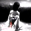 estirose: A girl sits before a hole, the only color being a red cord. (Sae looks over the abyss)