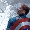 theleaveswant: still from Captain America: The First Avenger; Steve Rogers (Chris Evans) looking over his shoulder & shield, snowy bg (Captain Adorable)