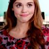 lydiascreams: (mock smile pursed lips stare neutral)