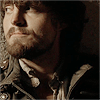muccamukk: Athos looking up with an ironic half smile. (Musketeers: Wry Look)