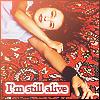 "veleda_k: Singer Tori Amos. Text says, ""I'm still alive"" (Tori Amos: Still alive)"