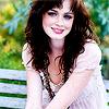dreamwriter_emmy: Alexis Bledel (brunette smiling sitting on a bench) (Default)