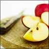 frangipani: sliced apples and a knife on a wooden chopping board (so are you to my thoughts)