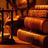 queen_ypolita: A stack of leather-covered books next to an hourglass (ClioBooks by magic_art)