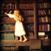 gairid: Little girl reaching for book (Books - Curiosity)