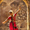 horusporus: An Indian dancer standing under an arch that is barely visible in this crop. (dansu)