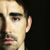 readyaimfuego: Lee Pace as Harry, face blank, staring directly at the viewer with opaque eyes (quiet long stare)