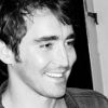 readyaimfuego: Lee Pace as Harry, smiling warmly, perhaps sheepishly (a smile)