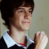 sonofaknight: late teen white boy, brown hair, half smile and fist up, possibly for bumps (daniel's got your back)