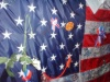 sashajwolf: photo of US flag with ribbons and tokens pinned to it (WTC)