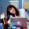 goodbyebird: Nurse Jackie: O'Hara is smiling from behind her laptop as she holds out a check. (NJ O'Hara)