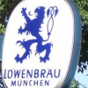 sashajwolf: photo of Lowenbrau sign in front of some trees (beer)