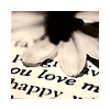 "sashajwolf: photo of a flower on a printed page with the word ""love"" visible (love)"
