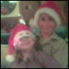 kit_r_writing: Two boys wearing Santa hats, smiling for the camera. (neffies)