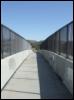 mindways: Across a bridge, half in shadow, with sky beyond (bridge, connection, crossing)