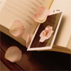 ext_106442: Petals on a book. (Book)