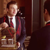 klainalysis: Picture of Kurt Hummel holding a canary cage while talking to Blaine Anderson.  Characters are from the US TV show Glee (kurt and pavarotti)