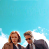 aceeccentric: Bright blue sky with white clouds behind Scully and Mulder. (Mulder and Scully)