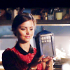 shinyjenni: Clara looks at a model of the TARDIS that Amy made (clara)