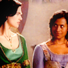rhivolution: Gwen and Morgana from BBC Merlin, giving each other a sidelong look (grace to the strong: Gwen/Morgana)