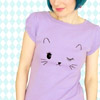 revolutions: A girl wearing a purple shirt with a cute anime-esque cat face on it. (kitty shirt)