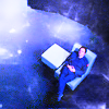 aceeccentric: Blue room with white light in upper left corner, human figure on a chair waiting patiently (Stargate Atlantis)