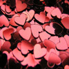 revolutions: Close-up of many small heart-shaped sequins. (a million hearts)